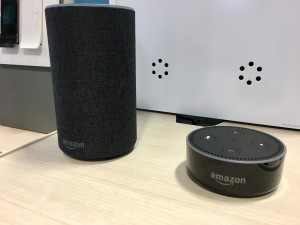 Two smart speakers on a table